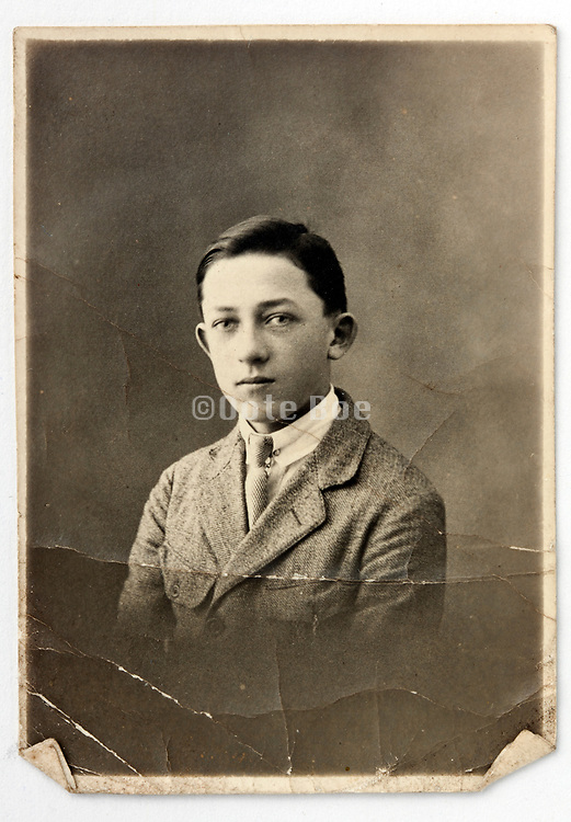 damaged vintage studio head and shoulder portrait of a young adult school boy