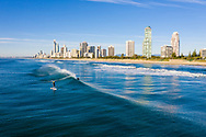 Aerial view of surfers off of Main Beach & Surfers Paradise skyline, Gold Coast, Queensland, Australia