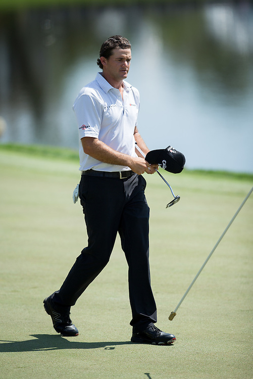 Mar 21, 2015; Orlando, FL, USA; Sam Saunders on the 18th green during the third round of the Arnold Palmer Invitational presented by MasterCard at Bay Hill Club & Lodge . Mandatory Credit: Kevin Liles-USA TODAY Sports