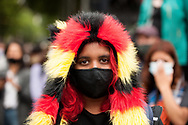 An young Aboriginal woman during a march through the city of Aboriginal people and their supporters in Melbourne on Australia Day (which they called, 'Invasion Day'). Australia marks the anniversary of the arrival of the First White Settlers in Australia. (Photo by Michael Currie/Speed Media)