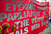 Anti -EU banner outside the Houses of Parliament on 23rd October, 2019 in London, England, United Kingdom. The government await news from the EU granting another Brexit extension. Last night Prime Minister Boris Johnson 'paused' discussions on his EU withdrawal bill after MPs voted against the government rushing it through in three days, Speaker John Bercow described the bill as bill now being in limbo.