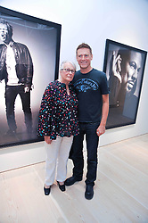 BRYAN ADAMS and his mother ELIZABETH ADAMS at an exhibition of photographic portraits by Bryan Adams entitled 'Hear The World' at The Saatchi Gallery, King's Road, London on 21st July 2009.