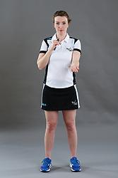 Umpire Louise Travis signalling toss up
