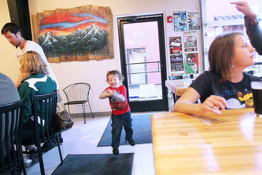 Breanna Hostbjor, right, enjoys a Pass Stout at Goodlife Brewing Company. Craft beer permeates the culture in Central Oregon city of Bend, with 10 breweries serving pints, growlers and kegs to a community of less than 90,000. Photographed Wednesday, April 25, 2012. Assignment ID 30125094A