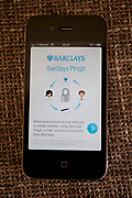 Pingit app being downloaded / used onto an iPhone. Barclays bank launched Europe's first money sending service that allows UK current account customers to send and receive cash through their mobile phones, 16th February 2012. Barclays' customers can download the bank's Pingit app to their smartphone and start making instant money transfers to anyone with a UK-based mobile phone and a current account with any UK bank. The app, which will be extended to all UK banking customers by early March, is free to use. It is aimed at an increasingly mobile-orientated public who use their phone to manage many aspects of their lives.