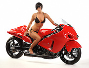 Beautiful brunette girl in bikini on a 2006 Hayabusa drag racing motorcycle.  No logos, model and property released, white background.