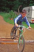 A5EWY6 Young boy doing jumps on his bike