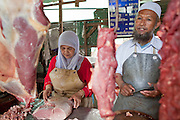 "Sept. 26, 2009 -- YALA, THAILAND: A Muslim couple sells halal beef (slaughtered according to Muslim tradition) in the market in Yala, Thailand. Thailand's three southern most provinces; Yala, Pattani and Narathiwat are often called ""restive"" and a decades long Muslim insurgency has gained traction recently. Nearly 4,000 people have been killed since 2004. The three southern provinces are under emergency control and there are more than 60,000 Thai military, police and paramilitary militia forces trying to keep the peace battling insurgents who favor car bombs and assassination.  Photo by Jack Kurtz / ZUMA Press"