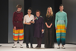 © Licensed to London News Pictures. 02/06/2015. London, UK. Ella Nisbett, Nottingham Trent University, winner of the Menswear Award and Stuart Peters Visionary Knitwear Award, pictured with Suzy Menkes and Laura Whitmore. Graduate Fashion Week 2015 concludes with the Gala Awards Show at the Old Truman Brewery, London. Photo credit : Bettina Strenske/LNP
