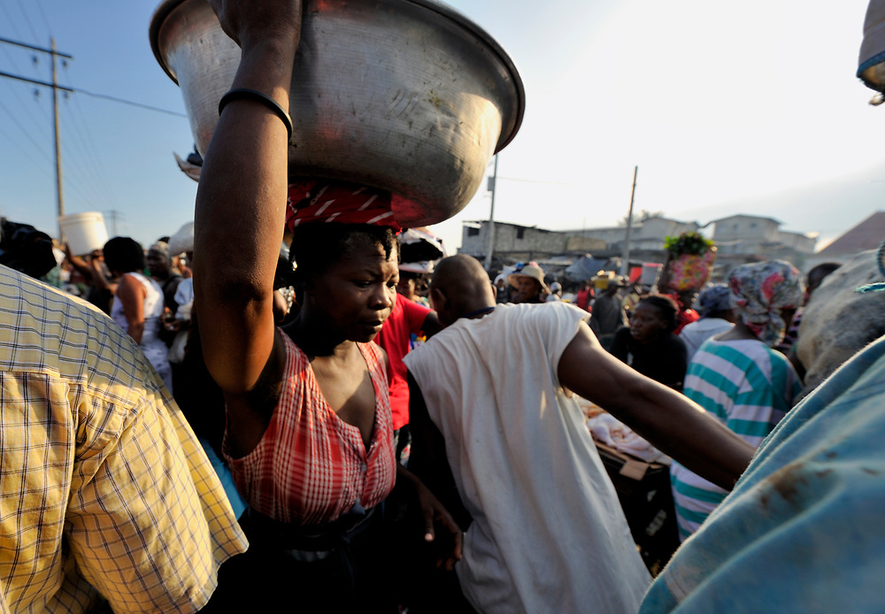 A woman carrying a basin in the Croix-des-Bossales market in the La Saline neighborhood of Port-au-Prince, Haiti.