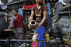 October 19, 2016 - Kathmandu, NP, Nepal - A Local Priest offering holy water to the devotees during a month Adinath Mela festival in Chobhar, Kirtipur, Kathmandu, Nepal on Wednesday, October 19, 2016. In the month of October or November from Kojagrat purnima to Kartik purnima for a month, people visit Adinath temple in the morning and perform special rituals puja and ritual function during Adinath Mela. (Credit Image: © Narayan Maharjan/NurPhoto via ZUMA Press)