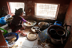 The restaurant dishwasher after lunch on day-7 of our Himalayan Heroes adventure riding from Tatopani to Pokhara, Nepal. Monday, November 12, 2018. Photography ©2018 Michael Lichter.