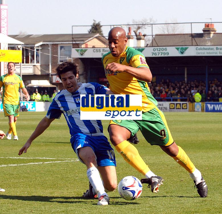 Photo: Ashley Pickering.<br />Colchester United v Norwich City. Coca Cola Championship. 31/03/2007.<br />Kem Izzet of Colchester (L) and Dion Dublin of Norwich