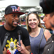LAS VEGAS, NV - APRIL 14: WBC/WBA welterweight champion Floyd Mayweather Jr. is supported by manager Kelly Swanson as he is  interviewed by members of the media before he works out at the Mayweather Boxing Club on April 14, 2015 in Las Vegas, Nevada. Mayweather will face WBO welterweight champion Manny Pacquiao in a unification bout on May 2, 2015 in Las Vegas.  (Photo by Alex Menendez/Getty Images) *** Local Caption *** Floyd Mayweather Jr., Kelly Swanson