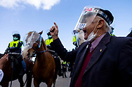 MELBOURNE, VIC - SEPTEMBER 05: An elderly man passionately calls for the end of lockdowns as he reminded the police of the Eureka Stockade during the Anti-Lockdown Protest on September 05, 2020 in Sydney, Australia. Stage 4 restrictions are in place from 6pm on Sunday 2 August for metropolitan Melbourne. This includes a curfew from 8pm to 5am every evening. During this time people are only allowed to leave their house for work, and essential health, care or safety reasons. (Photo by Dave Hewison/Speed Media)