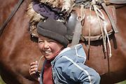 Young horseman at the Kurtka pass, Moldo-Too range of the Tian Shan mountains, Kyrgyzstan