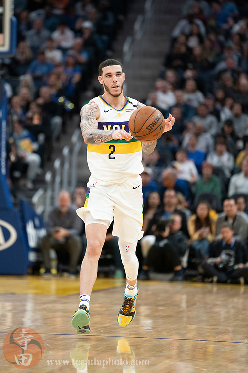 February 23, 2020; San Francisco, California, USA; New Orleans Pelicans guard Lonzo Ball (2) passes the basketball during the third quarter against the Golden State Warriors at Chase Center.