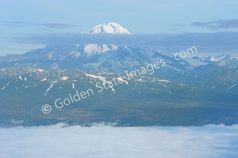 Alaska Scenic - Mount Redoubt Volcano<br />  <br /> Mount Redoubt is a 10,197 foot volcanic peak located about 100 miles southwest of Anchorage. Redoubt is one of two active volcanoes within Lake Clark National Park and Preserve. The other is Iliamna located further south. <br />  <br /> Location: Lake Clark National Park and Preserve Cook Inlet Alaska