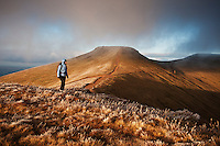 Female hiker with Corn Du and Pen Y Fan in Background, Brecon Beacons national park, Wales