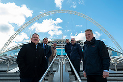© Licensed to London News Pictures. 15/04/2021. LONDON, UK. (Front row, L to R) Stephen Daniels, director of operations, and James Saunders, CEO of Quintain in front of executives at the photocall on the soon to be completed Olympic Steps at Wembley Stadium.  The 48 Olympic Steps comprises 4 flights of 12 steps and will become the new gateway to the stadium for visitors and fans arriving from Olympic Way and is due to be completed in June 2021 in time for England group stage matches at Euro 2020.  Photo credit: Stephen Chung/LNP