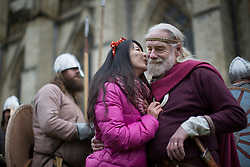 © licensed to London News Pictures. York, UK 23/02/2013. A re-enactment performer posing for a picture with a tourist before their 'battle' next to Clifford's Tower in York. Over 200 re-enactment performers meeting at Jorvik Viking Festival 2013 in York to fight a re-enactment battle as Vikings and Anglo-Saxon knights. Photo credit: Tolga Akmen/LNP