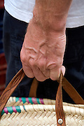 hand holding a shopping bag