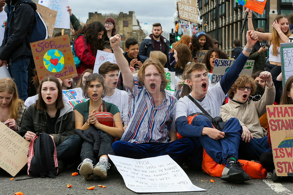 © Licensed to London News Pictures. 23/02/2019. London, UK. Hundreds of students with placards blocked Westminster Bridge during a climate change protest  highlighting the dangers of climate change. Photo credit: Dinendra Haria/LNP