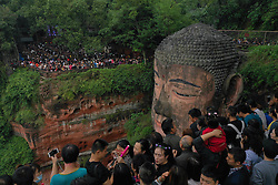 Oct. 4, 2018 - Leshan, China -  People view the statue of the Leshan Giant Buddha in Leshan City, southwest China's Sichuan Province. The Leishan Buddha scenic area received about 43,800 visitors on the fourth day of China's National Day holiday.  (Credit Image: © Jiang Hongjing/Xinhua via ZUMA Wire)