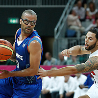 29 July 2012: Tony Parker of France drives by USA Deron Williams during the 98-71 Team USA victory over Team France, during the men's basketball preliminary, at the Basketball Arena, in London, Great Britain.