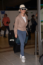 Michelle Yeoh arrives at the airport ahead of the 70th Cannes Film Festival in Nice, France, on May 17, 2017. Photo by Julien Reynaud/APS-Medias/ABACAPRESS.COM