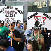 Protesters hold signs as they take part in a Black Lives Matter march, Saturday, August 26, 2017, in Seattle, Washington. Several thousand people attended a downtown rally and then marched through the city to call attention to minority rights and police brutality. (Alex Menendez via AP)