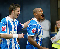 Photo: Chris Ratcliffe.<br />Colchester United v Queens Park Rangers. Coca Cola Championship. 16/09/2006.<br />Chris Iwelumo (R) of Colchester celebrates scoring the first goal with Greg Halford.