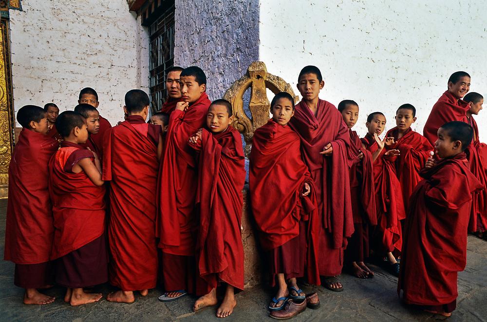 Buddhist novice monks take a break from classes at their monastery, Semtokha, Bhutan