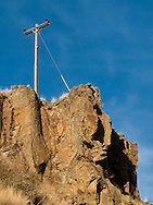 An electric power transmission pole stands braced on rocky land in the Grande Ronde River Canyon, WA, USA