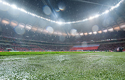 Water covers the grass at the stadium before the 2014 World Cup Qualifying Group H football match between Poland and England at National Stadium in Warsaw on October 16, 2012. The match was  postponed until tomorrow (October 17) 5 p.m...Poland, Warsaw, October 16, 2012..Picture also available in RAW (NEF) or TIFF format on special request...For editorial use only. Any commercial or promotional use requires permission...Photo by © Adam Nurkiewicz / Mediasport