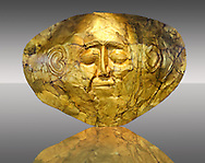 Gold Death Mask  from Grave Circle A, Mycenae. 16th Century BC. The mask is made of a thin sheet of beaten gold . 16th century BC.  Athens Archaeological Museum. .<br /> <br /> If you prefer to buy from our ALAMY PHOTO LIBRARY  Collection visit : https://www.alamy.com/portfolio/paul-williams-funkystock/mycenaean-art-artefacts.html . Type -   Athens    - into the LOWER SEARCH WITHIN GALLERY box. Refine search by adding background colour, place, museum etc<br /> <br /> Visit our MYCENAEN ART PHOTO COLLECTIONS for more photos to download  as wall art prints https://funkystock.photoshelter.com/gallery-collection/Pictures-Images-of-Ancient-Mycenaean-Art-Artefacts-Archaeology-Sites/C0000xRC5WLQcbhQ
