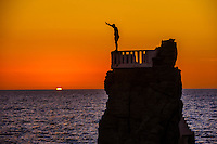 Cliff diver preparing to jump, the Malecon, Mazatlan, Sinaloa, Mexico