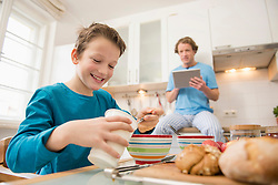 Father with digital tablet and son kitchen