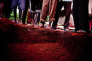 Relatives and friends of Baraka Josefati bury his corpse on a family plot. He was killed in an LRA ambush, and his body mutilated.