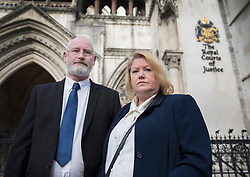 © Licensed to London News Pictures. 28/11/2017. London, UK. Geoff and Diane Gray stand for photographs after the High Court ruled that they have won the right to a fresh inquest into the death of their son Geoff Gray. 17 year old Private Geoff Gray died from two gunshot wounds to his head in Deepcut barracks in Surrey in 2001. The army said that he killed himself, but an inquest returned an open verdict. Four young recruits died in controversial circumstances at the military barracks. Photo credit: Peter Macdiarmid/LNP