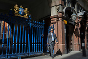 The entrance gates of Drapers' Hall livery company in Throgmorton Street, on 17th Juy 2017, in the City of London, England. The Drapers' Company is a Livery Company in the City of London whose roots go back to the 13th century, when as its name indicates, it was involved in the drapery trade. While it is no longer involved in the trade, the Company has evolved acquiring a new relevance. Its main role today is to be the trustee of the charitable trusts that have been left in its care over the centuries. The Company also manages a thriving hospitality business. The first Drapers' Hall was built in the 15th century in St Swithin's Lane.  It bought a Hall on the present site in Throgmorton Street in 1543 from King Henry VIII for £1,200 (about £350,000 in today's money). The Hall that the Company purchased from King Henry VIII in 1543 had been the private residence of Thomas Cromwell, Earl of Essex until his execution in 1540, when it was confiscated by the Crown.