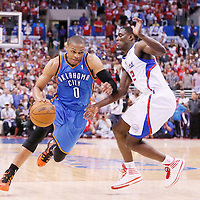 11 May 2014: Oklahoma City Thunder guard Russell Westbrook (0) drives past Los Angeles Clippers guard Darren Collison (2) during the Los Angeles Clippers 101-99 victory over the Oklahoma City Thunder, during Game Four of the Western Conference Semifinals of the NBA Playoffs, at the Staples Center, Los Angeles, California, USA.