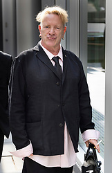 © Licensed to London News Pictures. 21/07/2021. London, UK.  John Lydon, former frontman of iconic punk band The Sex Pistols, once known as Johnny Rotten, leaves the High Court Rolls building in central London.  Bandmates Paul Cook and Steve Jones are suing Lydon over the use of their songs in a new Danny Boyle film. Mr Lydon is arguing that licences for the songs cannot be given without his consent. Photo credit: Peter Macdiarmid/LNP