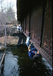 Kids Climbing On Railroad Trestle