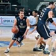 Anadolu Efes's Kerem TUNCERI (L) during their Turkish Airlines Euroleague Basketball Group C Game 6 match Anadolu Efes between Partizan at Sinan Erdem Arena in Istanbul, Turkey, Wednesday, November 23, 2011. Photo by TURKPIX