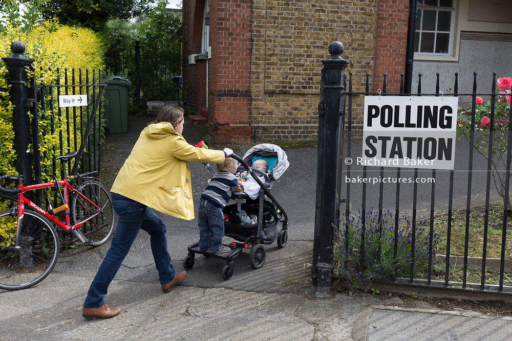 A voting mother arrives with children at the polling station on the morning of the UK 2017 general elections outside the polling station at St. Saviour's Parish Hall in Herne Hill, Lambeth, on 8th June 2017, in London, England.