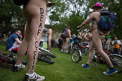 "© Licensed to London News Pictures. 12/06/2015. Manchester, UK. "" Deaf cyclist "" . Hundreds take part in the World Naked Bike Ride , which sees cyclists undress and cycle nude through Manchester City Centre . Photo credit: Joel Goodman/LNP"