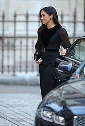 The Duchess of Sussex closes the door of the car she arrived in as she arrives at the opening of Oceania at the Royal Academy of Arts in London.