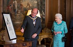 Queen Elizabeth II with Lord Provost Frank Ross during a reception for 603 (City of Edinburgh) Squadron, Royal Auxiliary Air Force, who have been honoured with the Freedom of The City of Edinburgh, at the Palace of Holyroodhouse in Edinburgh.