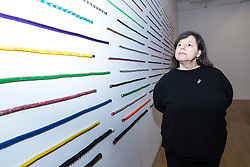 Brazilian artist Jac Leirner (born 1961) presents her first solo exhibition in Scotland, combining work from major collections with new work made especially for the Fruitmarket.<br /> <br /> The exhibition runs from 1 July - 22 October 2017 at the Fruitmarket Gallery in Edinburgh.<br /> <br /> Pictured: 120 Cords, 2014 with the artist Jac Leirner